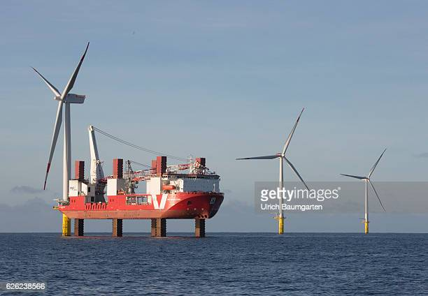 Wind turbines in the offshore wind farm Amrumbank West of the EON SE and the installation vessel for wind turbines MPI Resolution