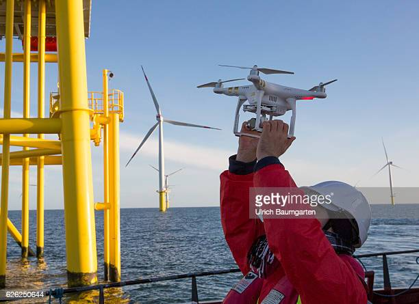 Wind turbines in the offshore wind farm Amrumbank West of the EON SE and a photo drone In the background a substation