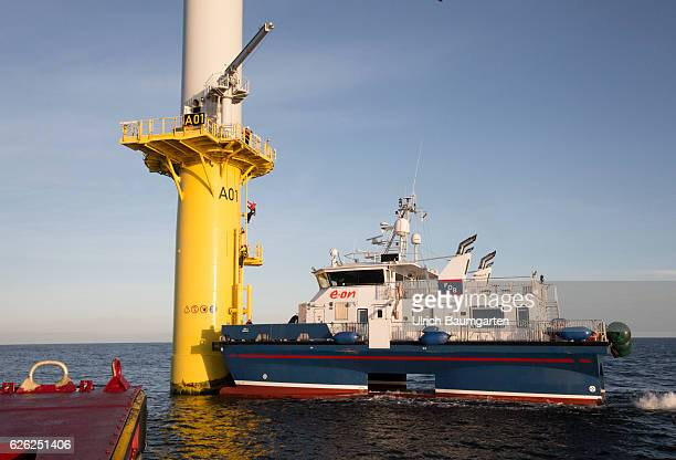 Wind turbines in the offshore wind farm Amrumbank West of the EON SE Technicians during maintenance work on a wind turbine and a supply vessel