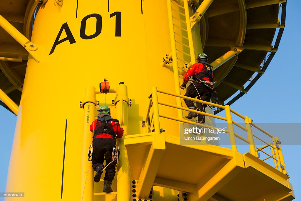 Wind turbines in the offshore wind farm Amrumbank West of the E.ON SE. Technicians during maintenance work on a wind turbine. : News Photo