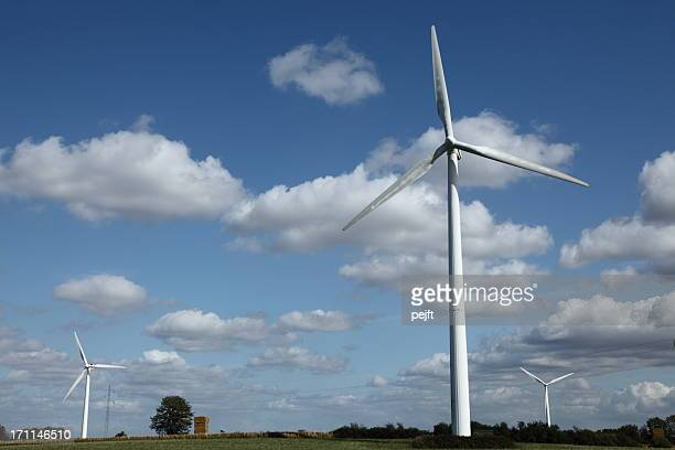 wind turbines in the summer landscape - pejft stock pictures, royalty-free photos & images