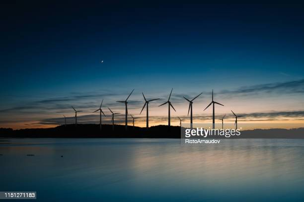 wind turbines landscape sunset - windmill stock pictures, royalty-free photos & images
