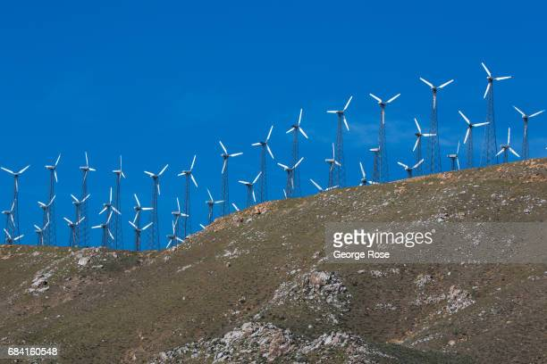 Wind turbines line a mountain ridge along Highway 58 as viewed on April 4 near Tehachapi California California Highway 58 stretches across the...