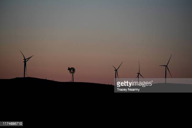 Wind Turbines Line the country side at sunset on August 30 2019 in Minoora Australia