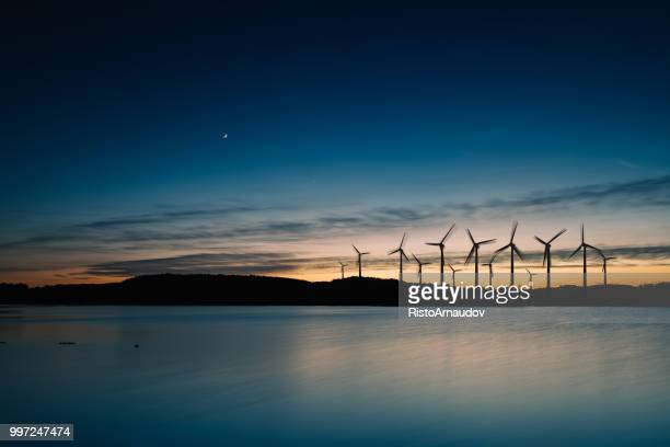 wind turbines motion landscape sunset - wind power stock pictures, royalty-free photos & images