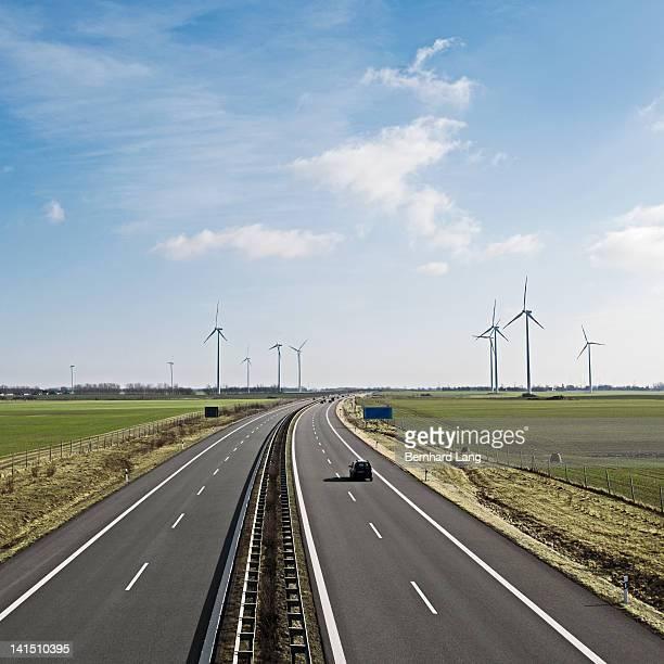 wind turbines next to highway, elevated view - メクレンブルク・フォアポンメルン州 ストックフォトと画像