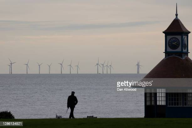 Wind turbines off the coast on November 16 2020 in FrintononSea England Wind energy features prominently in Prime Minister Boris Johnson's plan for a...