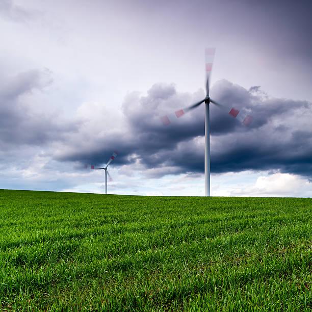 Wind Turbines On A Green Meadow. Wall Art
