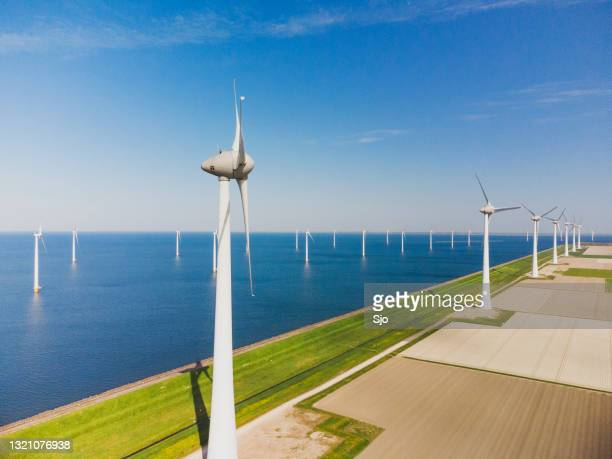"""wind turbines on a levee and offshore during springtime seen from above - """"sjoerd van der wal"""" or """"sjo"""" stock pictures, royalty-free photos & images"""