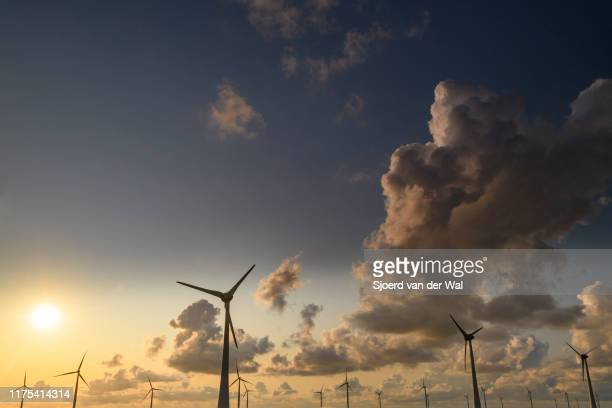 """wind turbines on a levee in a windpark during a summer sunset - """"sjoerd van der wal"""" stock pictures, royalty-free photos & images"""