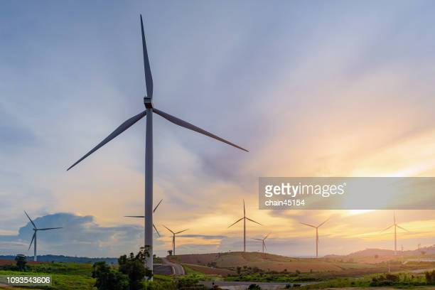 wind turbines on a summer day. green energy by clean and renewable energy. - mill stock pictures, royalty-free photos & images