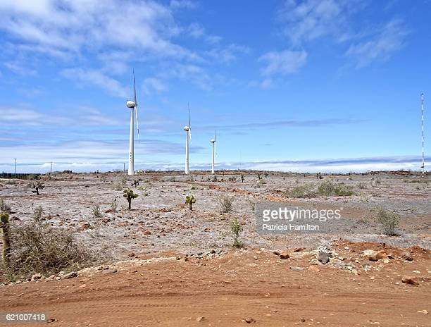 wind turbines on baltra island, galapagos - galapagos islands national park stock photos and pictures