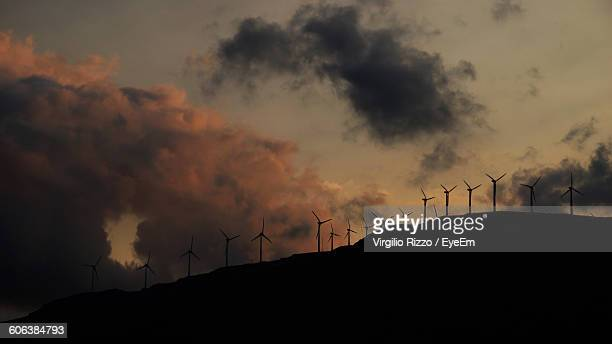 Wind Turbines On Silhouette Mountain During Sunset