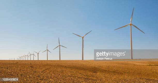 wind turbines on the field. spain - aragon fotografías e imágenes de stock