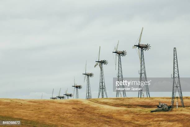 Wind turbines on the roadside with one of them broken by the wind, California, United States