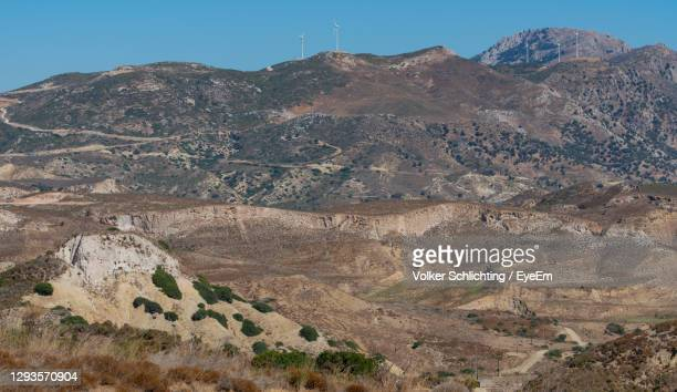 wind turbines onshore on the south coast on the island of kos greece - district heating plant stock pictures, royalty-free photos & images
