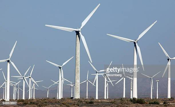 Wind turbines operate at China's largest wind farm just outside Urumqi, Xinjiang, China, on Thursday, September 14, 2006. China, the world's...