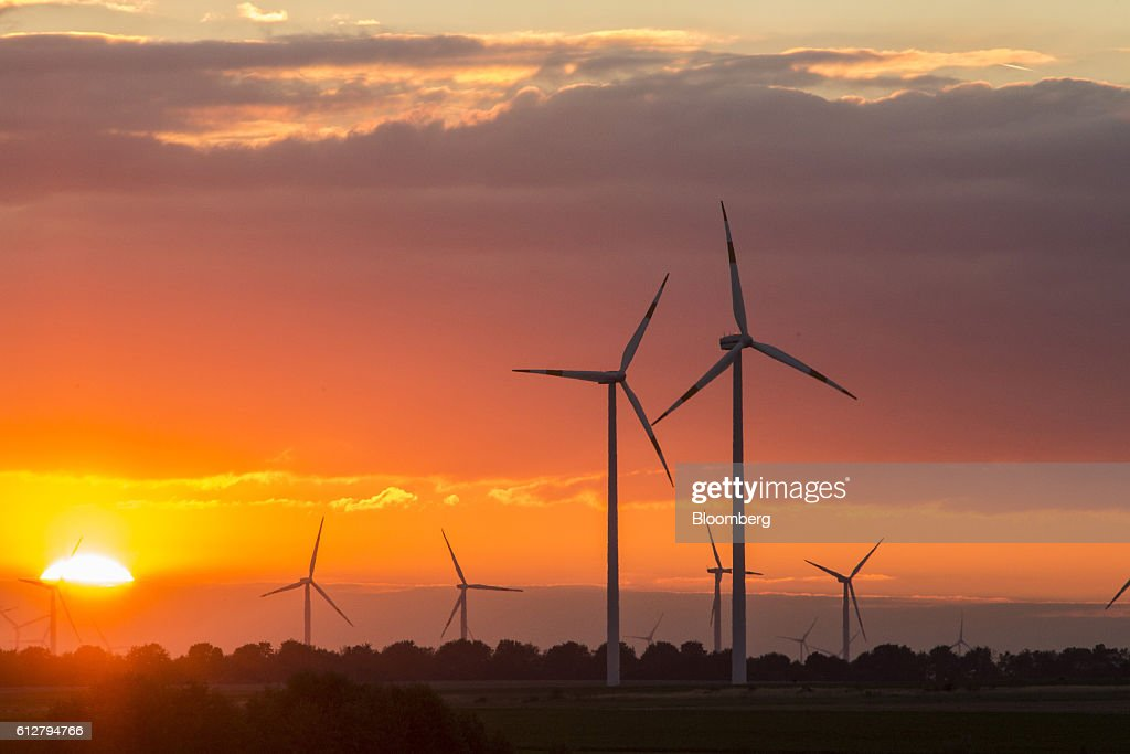 Wind turbines operate on the Innogy SE wind farm as the sun sets in Bedburg, Germany, on Tuesday, Oct. 4, 2016. RWE's green energy business Innogy has demand for all the shares for sale in its initial public offering as the company heads toward the biggest European listing in years. Photographer: Martin Leissl/Bloomberg via Getty Images