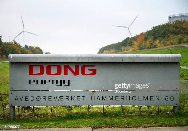 Wind turbines operated by Dong Energy A/S are seen at the company's Avedoerevaerket site in Hvidore Denmark on Tuesday Oct 15 2013 Dong Energy A/S...