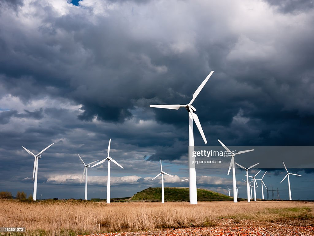Wind turbines photographed against a dark, stormy sky : Stock Photo