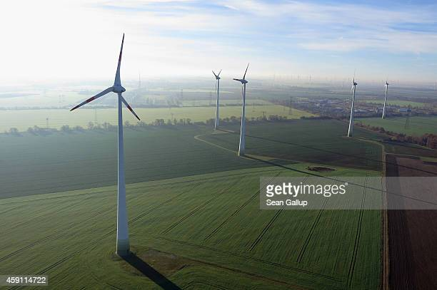 Wind turbines spin at a wind farm on November 17 2014 near Brieselang Germany Germany is extracating itself from nuclear energy and this year raised...