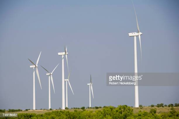 Wind turbines spin at the Lone Star Wind Farm on June 9 17 miles north of Abilene Texas The Lone Star Wind Farm project into its second phase is...