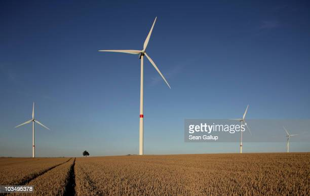 Wind turbines spin to produce electricity on August 19, 2010 near Proesitz, Germany. Germany is investing heavily in renewable energy production,...