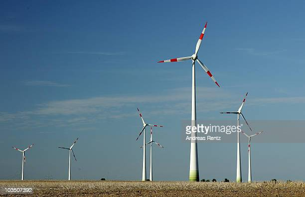 Wind turbines spin to produce electricity on August 20 2010 in Siebenhausen near Bitterfeld Germany Germany is investing heavily in renewable energy...