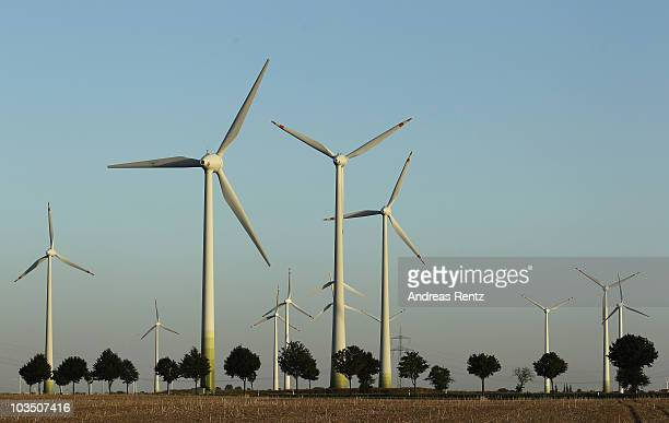 Wind turbines spin to produce electricity on August 20 2010 in Roedgen near Bitterfeld Germany Germany is investing heavily in renewable energy...