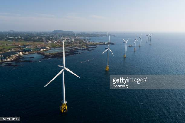 Wind turbines stand at a wind farm in this aerial photograph taken in Jeju South Korea on Wednesday June 14 2017 The election ofMoon Jaeinas South...