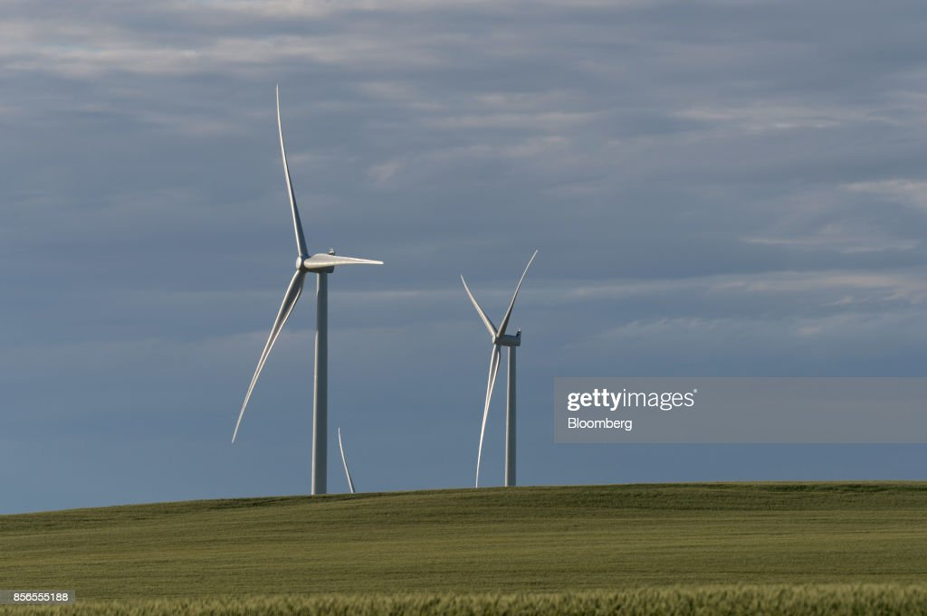 Wind turbines stand at the Hornsdale wind farm, operated by Neoen SAS, near Jamestown, South Australia, on Friday, Sept. 29, 2017. About half the capacity of the worlds largest lithium-ion battery project is installed at Hornsdale wind farm in South Australia, Tesla chief executive officer Elon Musk said at an event on Sept. 29. When this is done in just a few months, it will be the largest battery installation by a factor of three in the world, Musk said. Photographer: Carla Gottgens/Bloomberg via Getty Images
