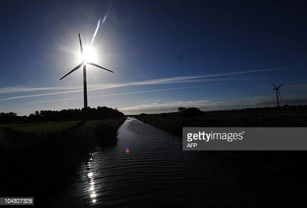 Wind turbines stand in a landscape near Husum northern Germany on September 21 2010 The Wind Energy 2010 fair is running in the northern city from...