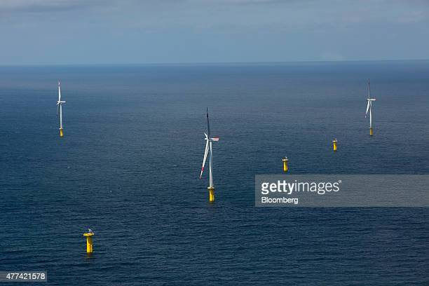 Wind turbines stand in the North Sea as installation and construction continues at Amrumbank West offshore wind park operated by EON SE off the coast...