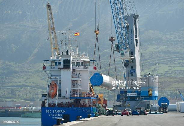 Wind towers are loaded on a ship at Bilbao´s harbour on April 20 2018
