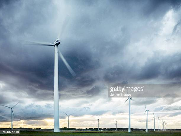 Wind turbines under evening sky