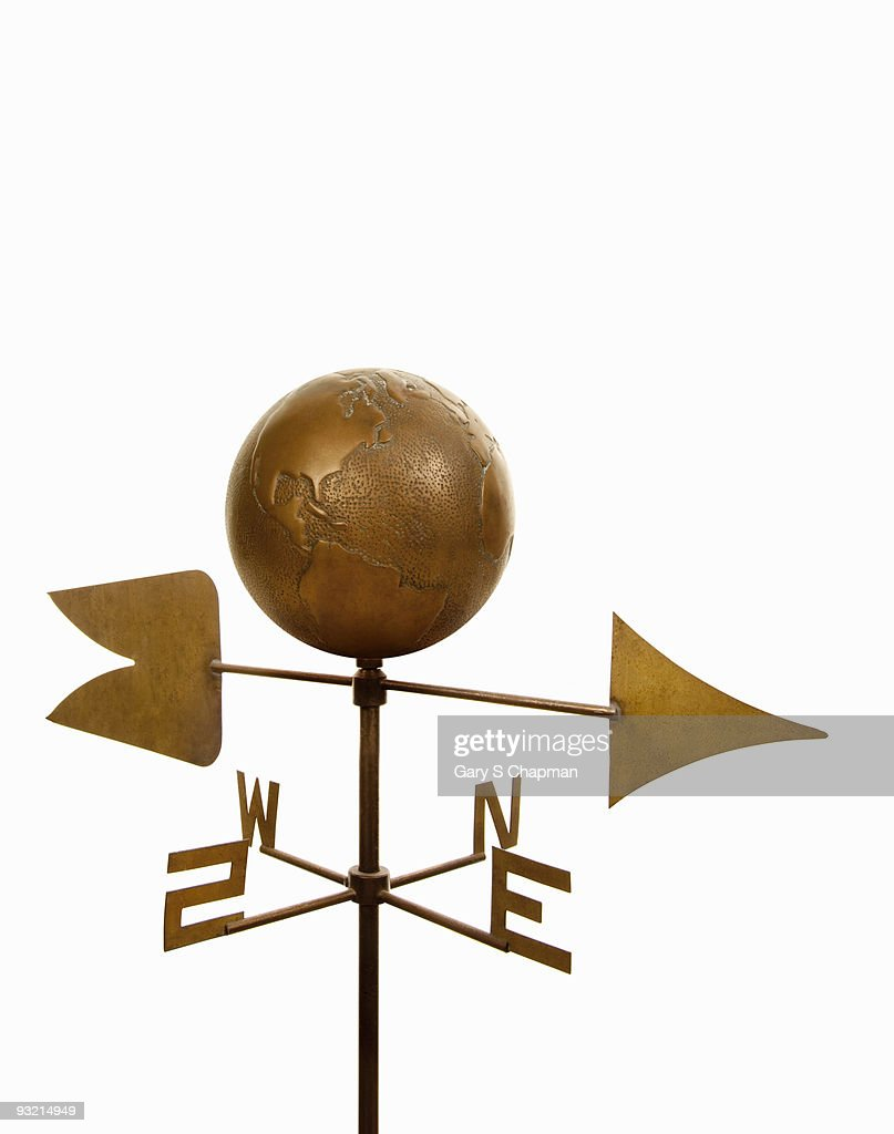Wind Vane With Antique Brass Globe On Top Stock Photo