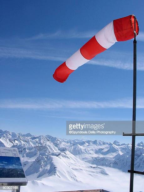 Windbag red white post ski mountains snowy stripes
