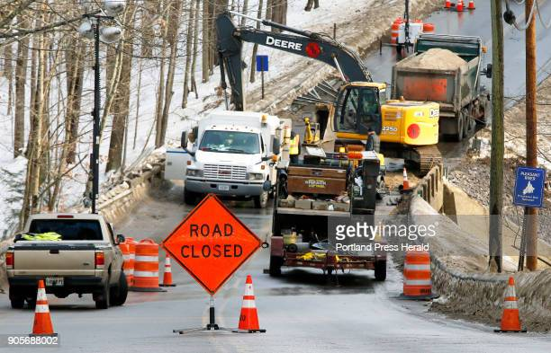 Windham Center Road was closed at the Pleasant River bridge while workers from Shaw Brothers Construction repaired a new section of water main on...