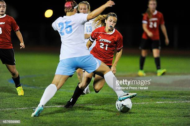 Windham High School versus Scarborough High School girls soccer game Scarborough's Katherine Kirk trys to get the ball past Windham defender Katie...