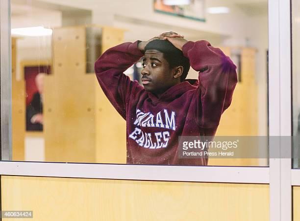 Windham student Jabari Washington watches the junior varsity game against Sanford high school at USM in Gorham ME on Wednesday December 17 2014...