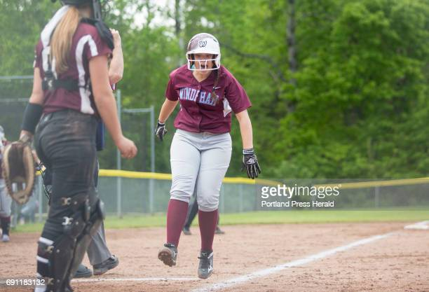 Windham's Alexandra Morang cheers as she runs into home from third after her teammate Olivia Mora hit a home run during their game against Noble at...