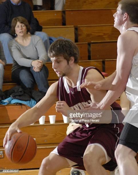 Windham's Jackson Taylor drives towards the basket with the ball against Thornton Academy Thursday Jan 28 2010