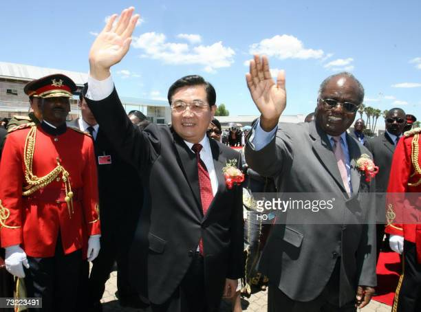 Chinese President Hu Jintao and his Namibian counterpart Hifikepunye Pohamba wave to the a welcoming crowd upon the Chinese leader arrival in...