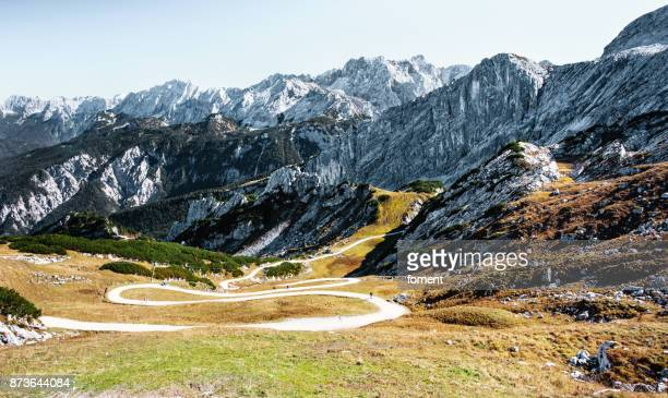 winding alpine road to valley - bavarian alps - germany stock pictures, royalty-free photos & images