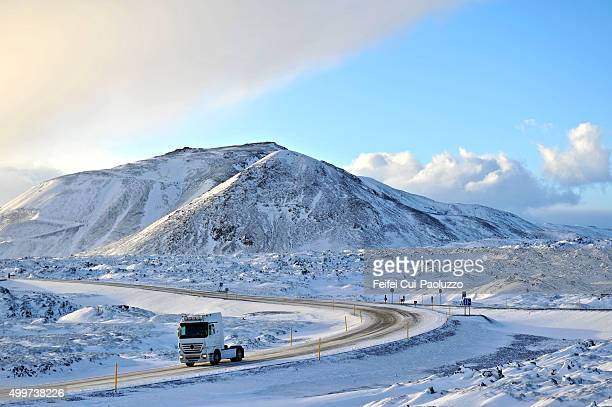 Winding and snowy road to Reykjavik Iceland