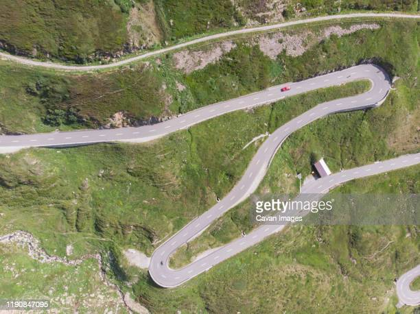 a winding and twisting road through the swiss mountains - drainage_basin stock pictures, royalty-free photos & images