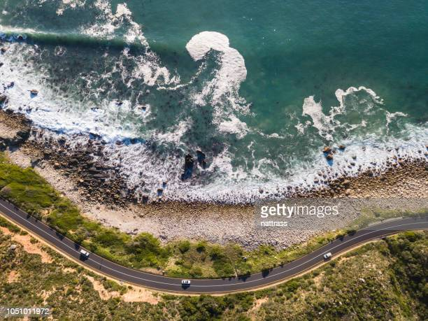 winding coastal road, cape town - south africa stock pictures, royalty-free photos & images