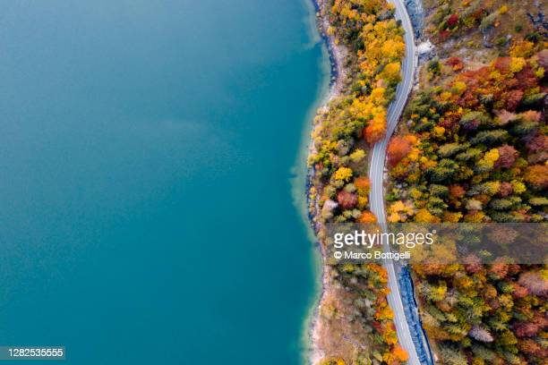 winding coastal road on turquoise colored lake - germany stock pictures, royalty-free photos & images