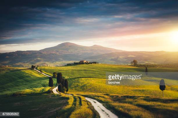 Winding Country Road Over Tuscany Hills