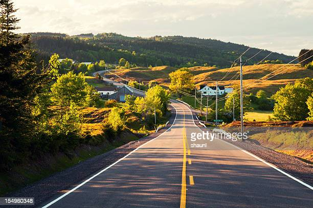 winding country road - nova scotia stock pictures, royalty-free photos & images